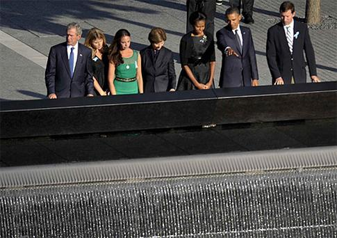 Former US President George W Bush , Jenna Bush, Barbara Bush, Laura Bush, first lady Michelle Obama, President Obama, and Henry Hager, husband of Jenna Bush, look at the North Memorial Pool of the National September 11 Memorial