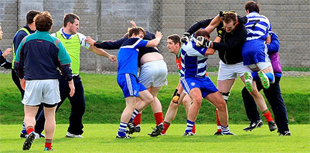 Players from Blessington and Rathnew brawl in Aughrim, Co Wicklow yesterday