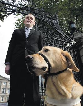 Kevin Kelly with guide dog Miles at Leinster House in Dublin yesterday