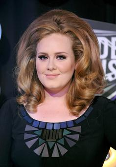Adele is to be recognised for a hat-trick of achievements by Guinness World Records. Photo: PA