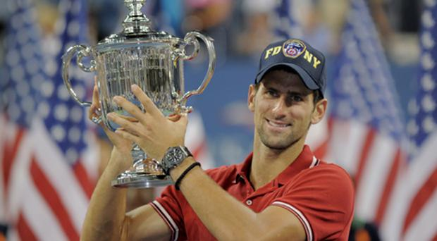 Novak Djokovic holds the trophy after his win over Rafael Nadal at the US Open. Photo: Getty Images