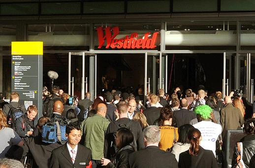 Shoppers rush into Westfield Stratford City shopping centre in east London, Europe's largest urban shopping centre and gateway to the new Olympic Park, as it opened its doors to the public. Photo: PA