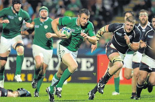 Tommy Bowe races through the USA defence during Ireland's win at the Stadium Taranaki in New Zealand on Sunday