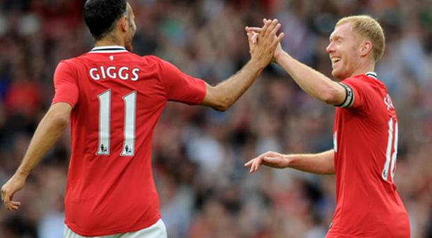 Ryan Giggs wishes his old mate Paul Scholes had not quit in the summer. Photo: Getty Images