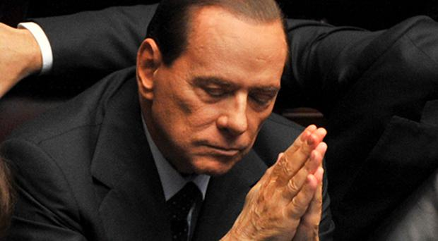 Italian Prime Minister Silvio Berlusconi reacts during a session of the Italian parliament today. Photo: Getty Images