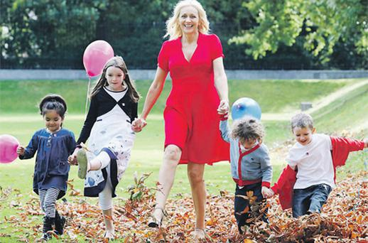 Anam Cara ambassador Miriam O'Callaghan in Dublin's Iveagh Gardens yesterday with, from left, Susie Kelly (4) from Dundrum, Sophie (8) and Matthew Farrell (3) from Stillorgan – whose brother Daniel died at 15 months – and David Burke (5) from Rathfarnham