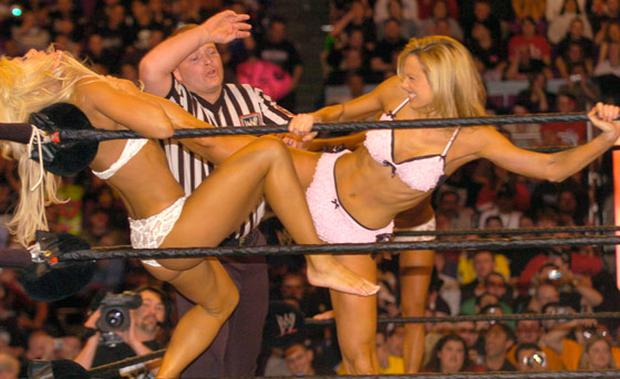 George Clooney's new kick ass girlfriend Stacy Keibler (right) in the ring at Wrestle Mania XX at Madison Square Garden on March 14, 2004 in New York