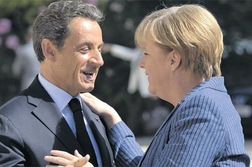 French President Nicolas Sarkozy greets German Chancellor Angela Merkel in Paris recently