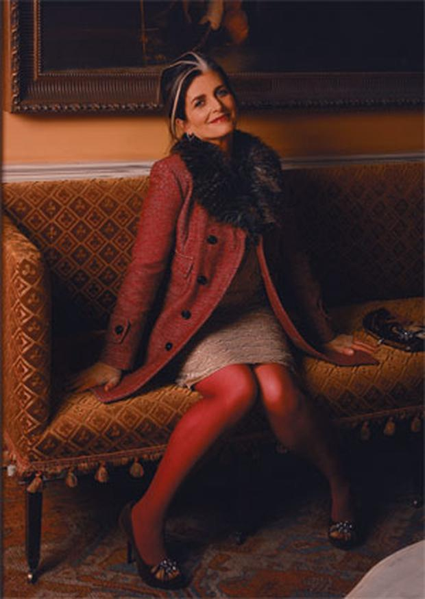 Cathy O'Connor, 50, stylist, wears: Coat, €124; dress, €104, both South. Shoes, €59; Bag, €39; both Love Label. Gloves; tights, both stylist's own