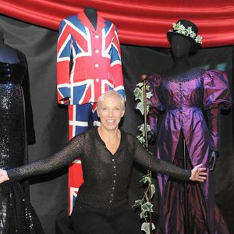 Annie Lennox poses with some of the costumes she has designed at her new exhibition