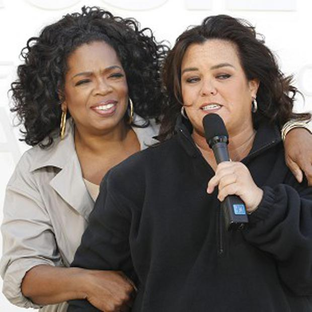 Oprah Winfrey and Rosie O'Donnell outside Harpo Studios in Chicago (AP)