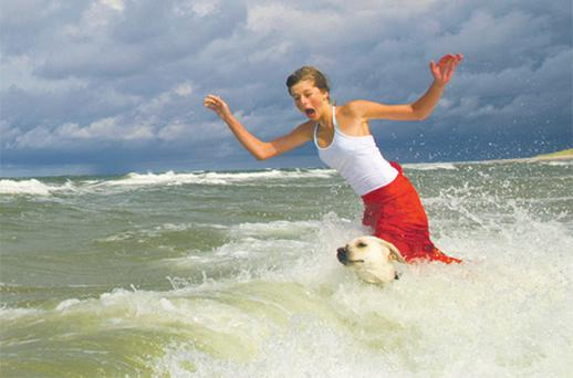 A dog's best friend? A woman takes a dip with her pet dog