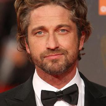 Gerard Butler will wait and see about a 300 sequel