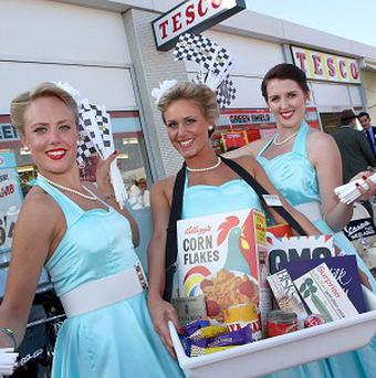 Assistants outside a 1960s store recreated by supermarket giant Tesco at this weekend's Goodwood Revival historic motor race meeting (Tesco/PA)