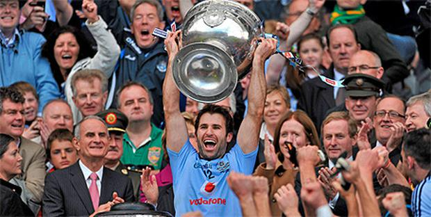Dublin captain Bryan Cullen lifts the Sam Maguire cup. Photo: Sportsfile