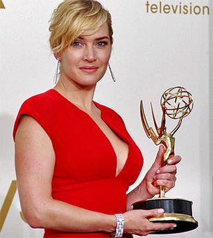 Kate Winslet accepts the Emmy award for outstanding lead actress in a miniseries or movie for her role in