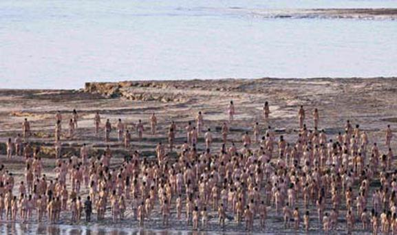 More than 1,000 nude Israelis pose for American art photographer Spencer Tunick's first Middle East mass shoot at the shores of the Dead Sea, Israel.