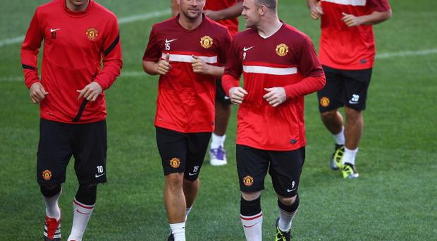 Wayne Rooney talks with Michael Owen during training. Photo: Getty Images