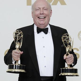 Downtown Abbey writer Julian Fellowes holds Emmys for best miniseries or movie and best writing for a mini-series or movie (AP)