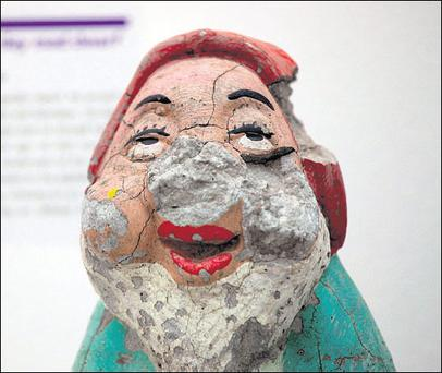 Gnome alone You glimpse a half-smashed garden gnome - known as 'The Divorce Day Gnome' — that was thrown in a rage at the car of a departing husband