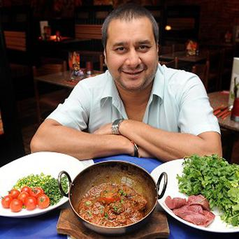 Sanjay Majhu with an eco friendly curry he created by using only home grown ingredients