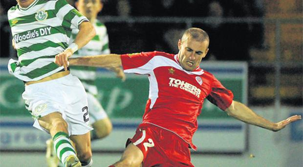 Sligo's Alan Keane slides in to dispossess Shamrock Rovers' Ronan Finn during last night's FAI Ford Cup quarter-final