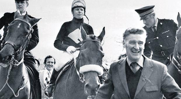 'Ginger' McCain leads in Red Rum and jockey Brian Fletcher after the horse's success in the 1974 Aintree Grand National