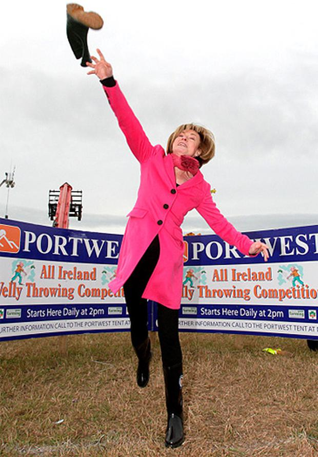 Presidential candidate Mary Davis tries her hand at Portwest throwing the wellie competition