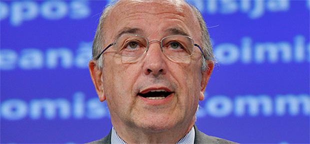 European Competition Commissioner Joaquin Almunia holds a meeting in Brussels yesterday