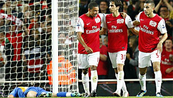 Yossi Benayoun celebrates scoring Arsenal's third goal