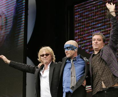 FILE - In this July 2, 2005 file photo, R.E.M. band members, from left, Mike Mills, Michael Stipe and Peter Buck wave as their leave the stage, at the Live 8 concert in Hyde Park in London. The band announced Wednesday, Sept. 21, 2011 on their website that they are breaking up. (AP Photo/Lefteris Pitarakis, file)