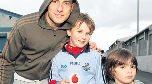 Charlie Meehan (10) and Ryan McGuirk (6) with Bernard Brogan at the match in Parnell Park last night