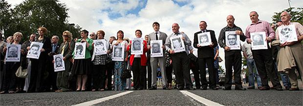 Relatives of those shot dead on Bloody Sunday at a march in Derry ahead of the release of the Saville report in 2010