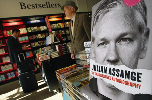 Members of the public walk past copies of the Unauthorized Autobiography of Wikileaks founder Julian Assange on sale in Waterstones bookstore on September 22. Photo: Getty Images
