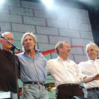 Dave Gilmour (from left), Roger Waters, Nick Mason and Rick Wright of Pink Floyd together on stage
