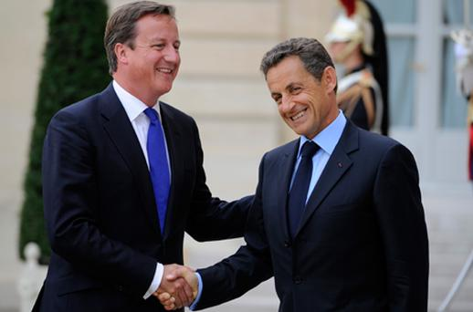 British Prime Minister David is greeted by French President Nicolas Sarkozy ahead of the international summit to build support for the fledgling Libyan rebel administration. Photo: Getty Images
