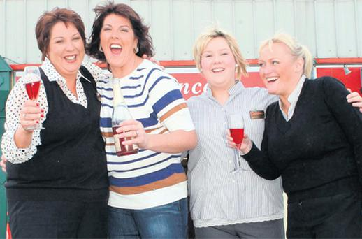 Annette Howard and Mandy Brogan celebrate the sale of the winning Lotto ticket at their Eurospar shop in Belmullet, Co Mayo, yesterday with manager Mary B Walsh and Annette's daughter Aileen