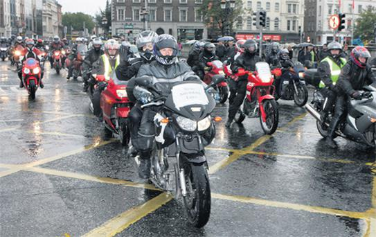 Members of the Motorcyclists' Action Group take part in protests in Dublin