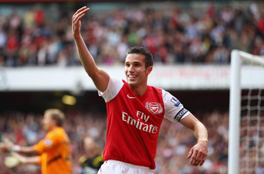 Robin Van Persie of Arsenal celebrates his second goal during the Barclays Premier League match between Arsenal and Bolton. Photo: Getty Images