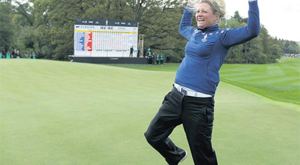 Suzann Pettersen of Europe celebrates after her team secured the Solheim Cup at Killeen Castle yesterday