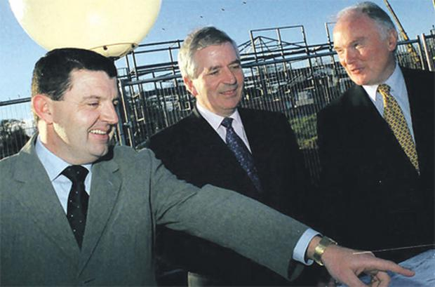 Gerry Conlan (left) with the then Finance Minister Charlie McCreevy (centre) and Michael Mullally, CEO Millennium Park, at Millennium Park in Naas, Co Kildare