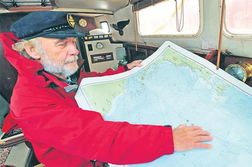 Arvid Moe from Norway – part of the two-man crew that was feared lost in the Atlantic – works on the rest of their trip from Portmagee Pier in south Kerry