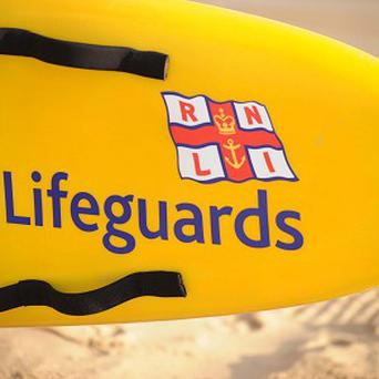 RNLI lifeguards had to rescue their own truck at Booby's Bay when it got stuck in soft sand