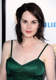File photo dated 22/05/2011 of actress Michelle Dockery, who has revealed that Downton Abbey viewers can expect a wedding, a funeral and a sex scene in the coming episodes of the hit period drama. PRESS ASSOCIATION Photo. Issue date: Tuesday September 27, 2011. In an interview about the quintessential television programme, which stars Hugh Bonneville and Dame Maggie Smith, the 29-year-old says devotees to the show will be