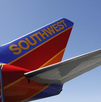 A lesbian actress claims she was escorted off a Southwest Airlines flight for kissing her girlfriend