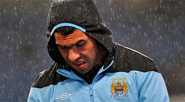 Carlos Tevez refused to leave the substitutes' bench when called upon in the second half