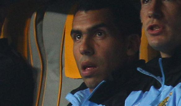 Carlos Tevez refused to leave the substitutes' bench when called upon in the second half. Photo: Getty Images