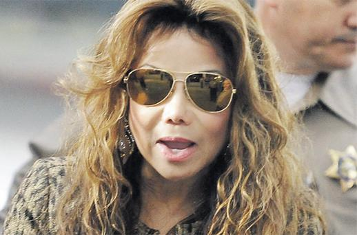 Michael Jackson's sister La Toya arriving yesterday for Dr Conrad Murray's trial in connection with the death of the pop star