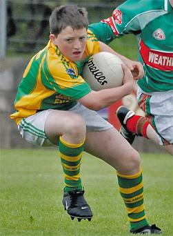 Jonathan in action for Kilmacabea
