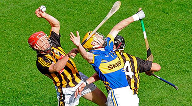 Lar Corbett is out-jumped by Kilkenny's Tommy Walsh in the All-Ireland final